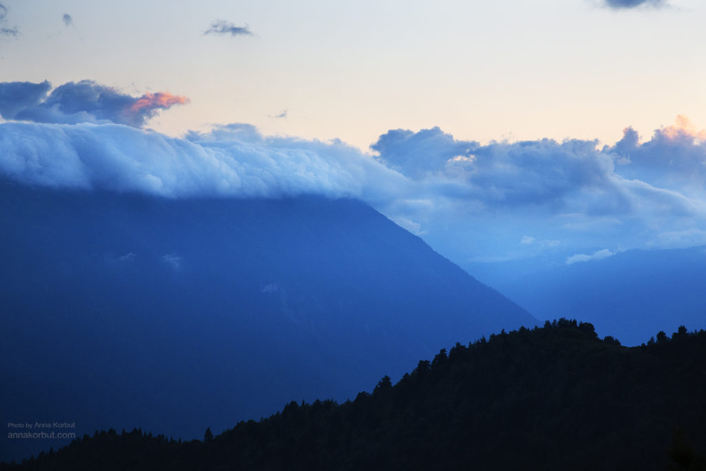Hiking in Caucasian mountains is a beautiful experience. We often put a tent in high places to observe sunset. In the evening clouds came on the mountain, moving like a huge wave. Photo made from pass Bak near village Mazeri.